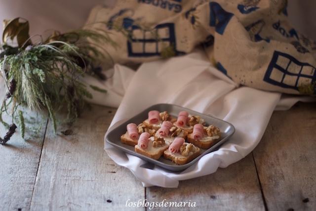 Aperitivo de queso, nueces y jamón cocido